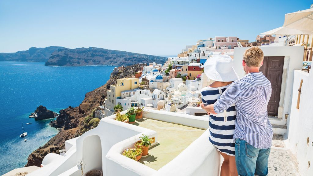 A couple looks out over Santorini