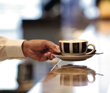 A server holding a coffee cup