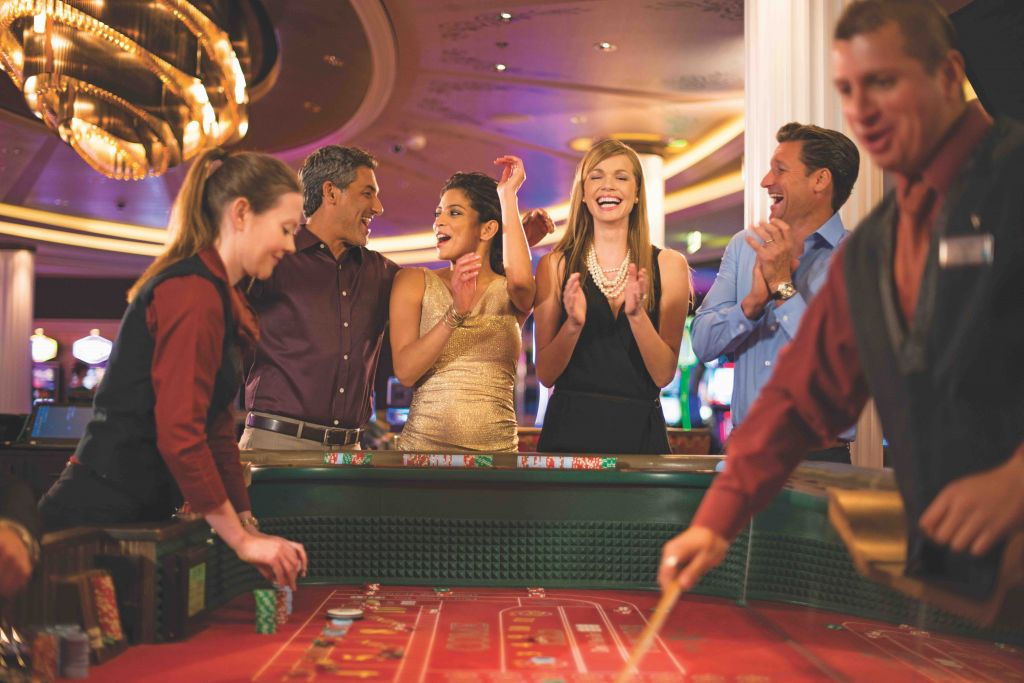 casino, craps, fun, gambling, Fortunes Casino, onboard entertainment, group shot, playing craps, Solstice Class, Millennium Class