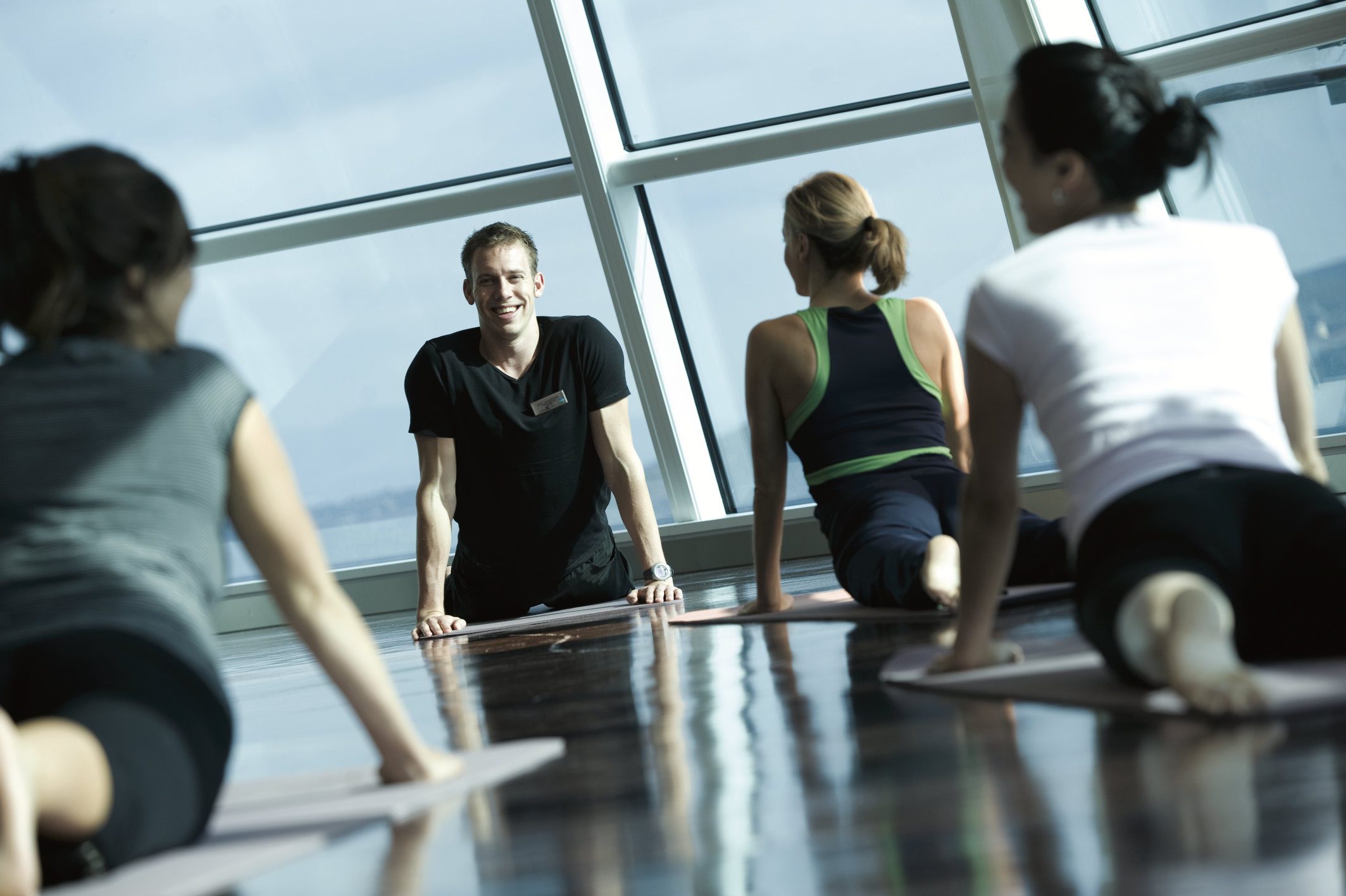 Group doing yoga onboard a Celebrity Cruise