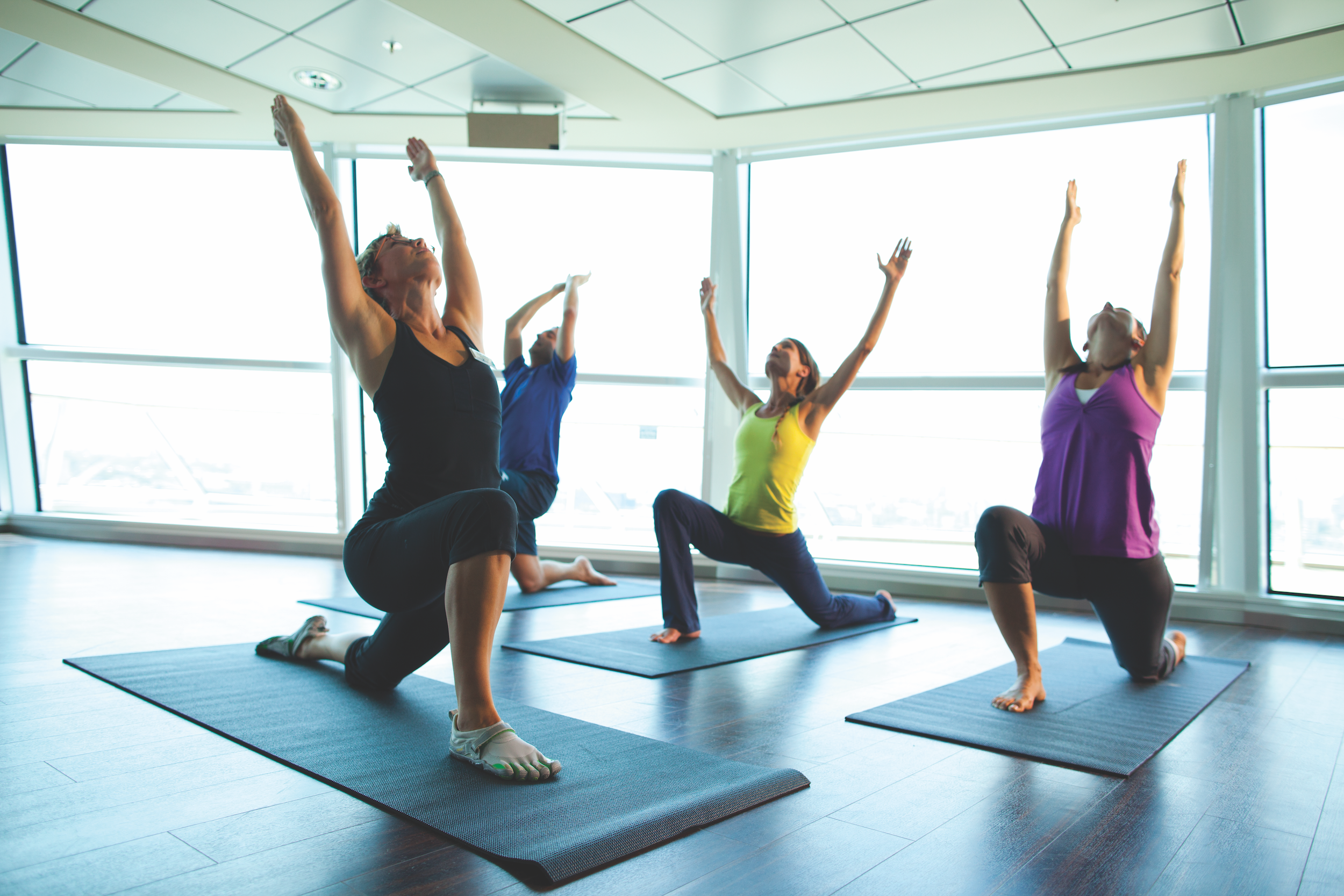 Group of 4 people doing yoga